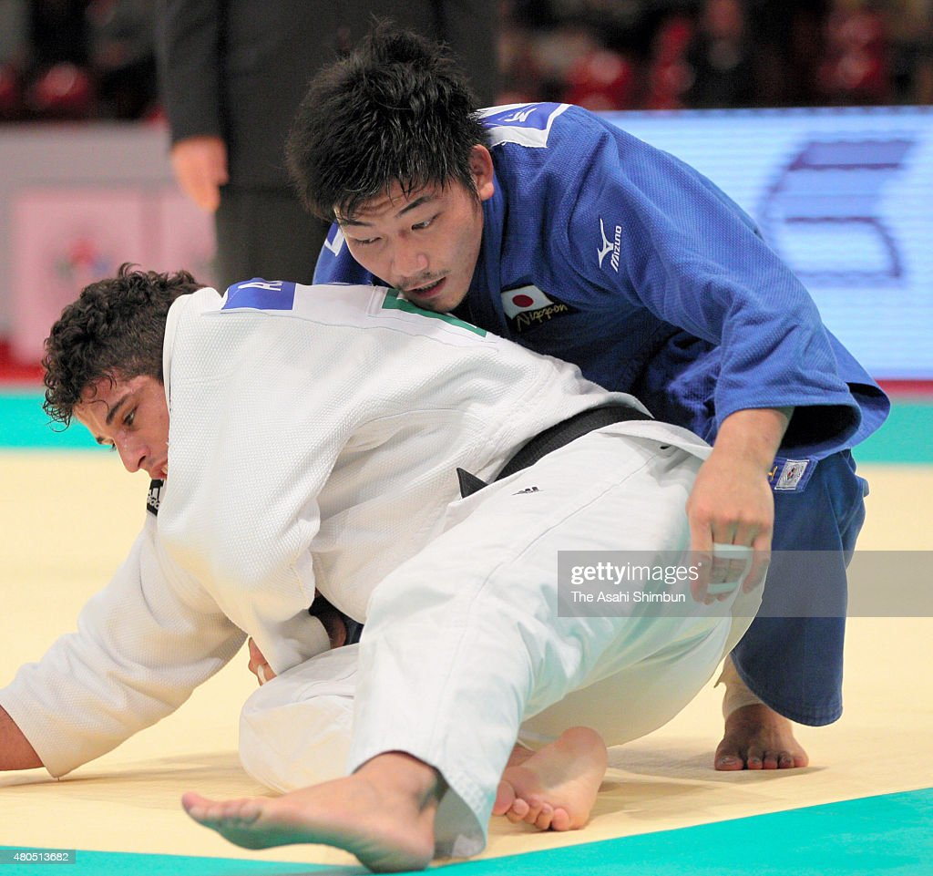 Masashi Nishiyama (blue) of Japan and Asley Gonzalez of Cuba compete in the Men's -90kg final during day two of the Judo Grand Slam Tokyo at Tokyo Metropolitan Gymnasium on December 10, 2011 in Tokyo, Japan.