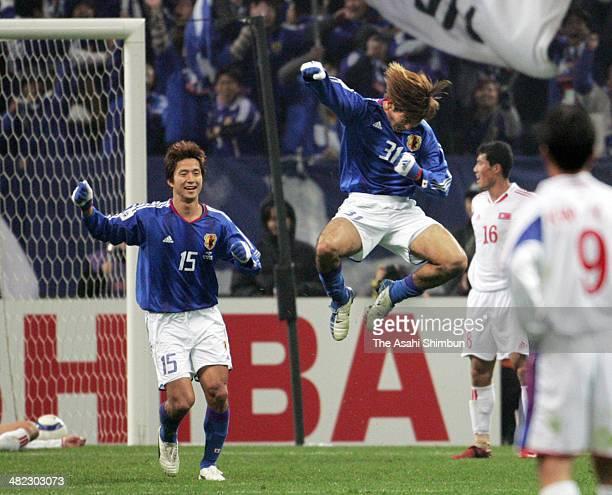 Masashi Oguro of Japan celebrates scoring his team's second goal with his teammate Takashi Fukunishi during the Germany World Cup Asian Qualifer...