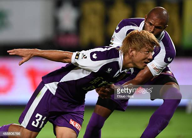 Masashi Oguro of Kyoto Sanga celebrates scoring his team's first goal with his team mate Ferro during the JLeague second division match between JEF...