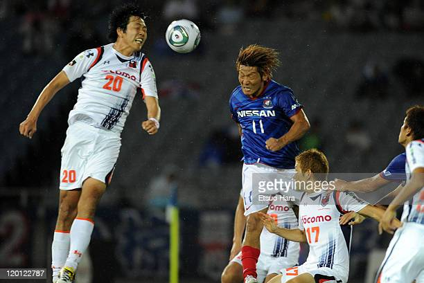 Masashi Oguro of Yokohama F Marinos scores the second goal during the JLeague match between Yokohama F Marinos and Omiya Ardija at Nissan Stadium on...