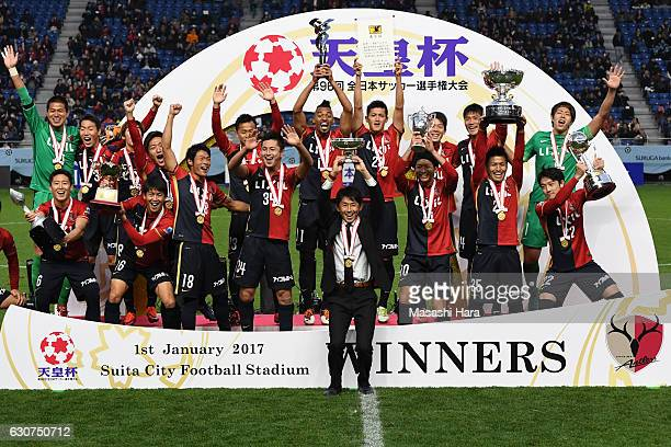 Masatada Ishii of Kashima Antlers lifts the Cup after the 96th Emperor's Cup final match between Kashima Antlers and Kawasaki Frontale at Suita City...