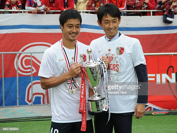Masatada Ishiicoach and Mitsuo Ogasawara of Kashima Antlers look on after the JLeague Yamazaki Nabisco Cup final match between Kashima Antlers and...