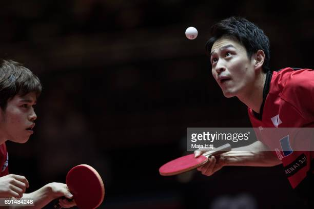 Masataka Morizono and Yuya Oshima of Japan compete during Men's Doubles quarter finals at Table Tennis World Championship at Messe Duesseldorf on...