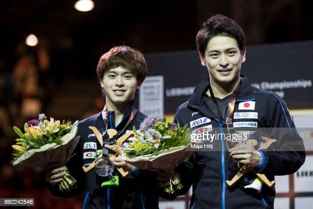 Masataka Morizono of Japan and Yuya Oshima of Japan pose with a silver medal during celebration ceremony of Men's Doubles at Table Tennis World...