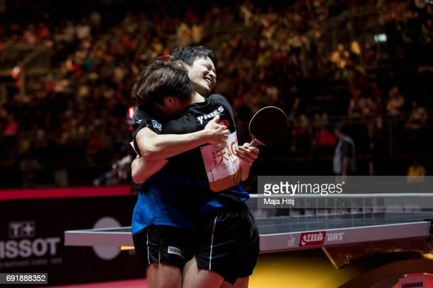 Masataka Morizono of Japan and Yuya Oshima of Japan react after winning Men's Doubles SemiFinals at Table Tennis World Championship at Messe...
