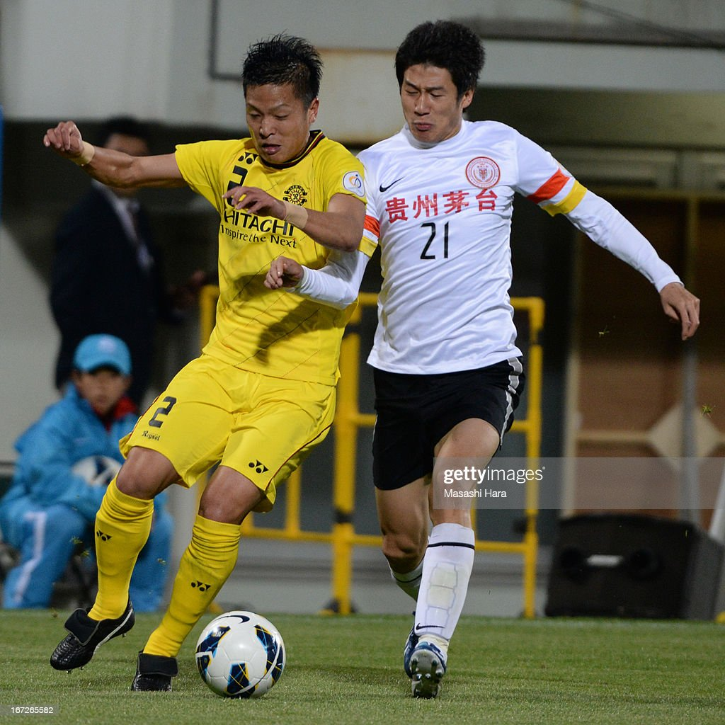 Masato Fujita #2 of Kashiwa Reysol (L) and Yu Hai #21 of Guizhou Renhe compete for the ball during the AFC Champions League Group H match between Kashiwa Reysol and Guizhou Renhe at Hitachi Kashiwa Soccer Stadium on April 23, 2013 in Kashiwa, Japan.