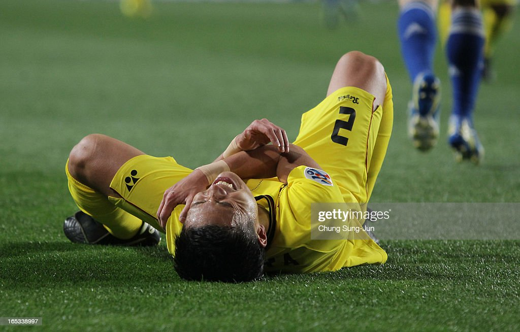 Masato Fujita of Kashiwa Reysol lies on the ground injured during the AFC Champions League Group H match between Suwon Bluewings and Kashiwa Reysol at Suwon World Cup Stadium on April 3, 2013 in Suwon, South Korea.