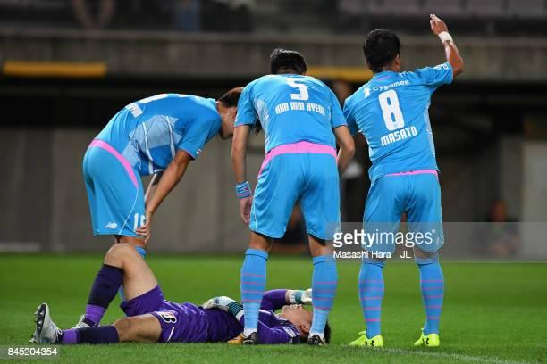 Masato Fujita of Sagan Tosu calls for medical treatment for Shuichi Gonda during the JLeague J1 match between Vegalta Sendai and Sagan Tosu at Yurtec...