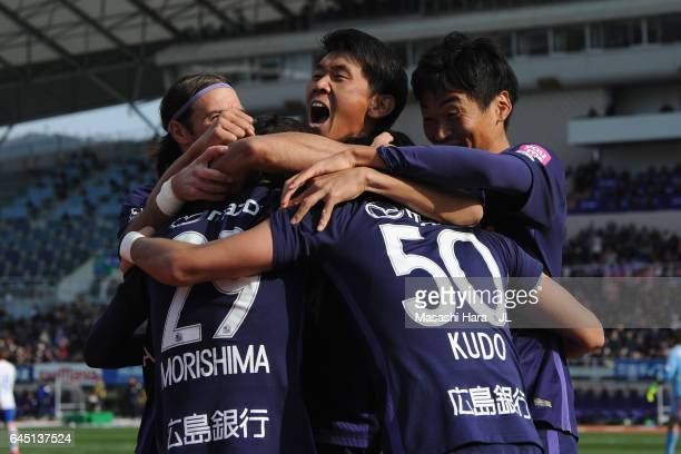 Masato Kudo of Sanfrecce Hiroshima celebrates scoring the opening goal with his team mates Mihael Mikic Tsukasa Morishima Hiroki Mizumoto and...