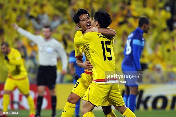 Masato Kudo and Kosuke Taketomi of Kashiwa Reysol celebrate the first goal during the AFC Champions League playoff round match between Kashiwa Reysol...