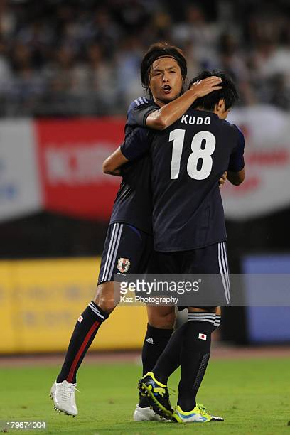 Masato Kudo of Japan is congratulated by teammate Yasuhito Endo after scoring their team's second goal during the international friendly match...