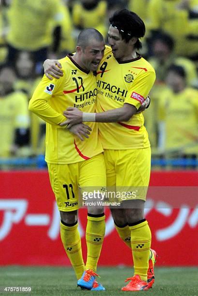 Masato Kudo of Kashiwa Reysol celebrates scoring his team's first goal with his teammate Leandro Montera da Silva during the J League match between...