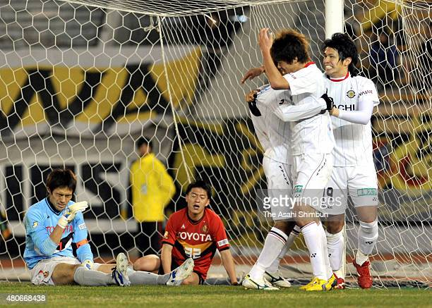 Masato Kudo of Kashiwa Reysol celebrates scoring his team's second goal with his team mates while Seigo Narazaki and Hayuma Tanaka of Nagoya Grampus...