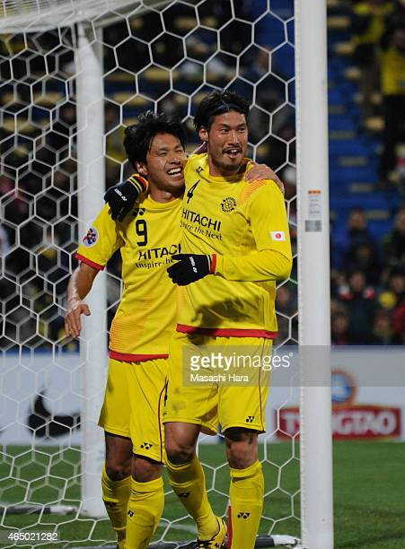 Masato Kudo of Kashiwa Reysol celebrates the fourth goal with Daisuke Suzuki during the AFC Champions League Group E match between Kashiwa Reysol and...