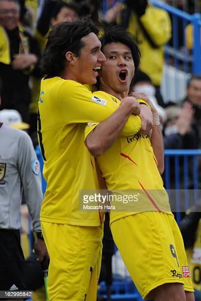 Masato Kudo of Kashiwa Reysol celebrates the third goal with Cleo during the JLeague match between Kashiwa Reysol and Kawasaki Frontale at Hitachi...