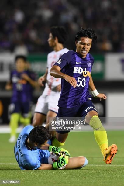 Masato Kudo of Sanfrecce Hiroshima and Kenya Matsui of Omiya Ardija compete for the ball during the JLeague J1 match between Sanfrecce Hiroshima and...