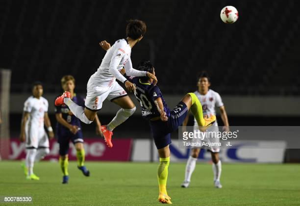 Masato Kudo of Sanfrecce Hiroshima and Kosuke Kikuchi of Omiya Ardija compete for the ball during the JLeague J1 match between Sanfrecce Hiroshima...