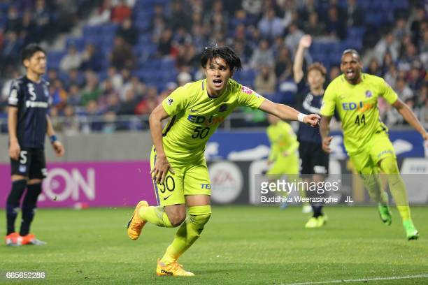 Masato Kudo of Sanfrecce Hiroshima celebrates scoring the opening goal during the JLeague J1 match between Gamba Osaka and Sanfrecce Hiroshima at...
