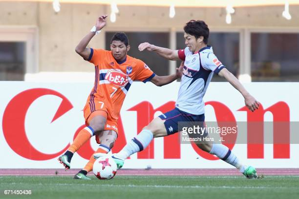 Masato Morishige of FC Tokyo and Rony of Albirex Niigata compete for the ball during the JLeague J1 match between Albirex Niigata and FC Tokyo at...