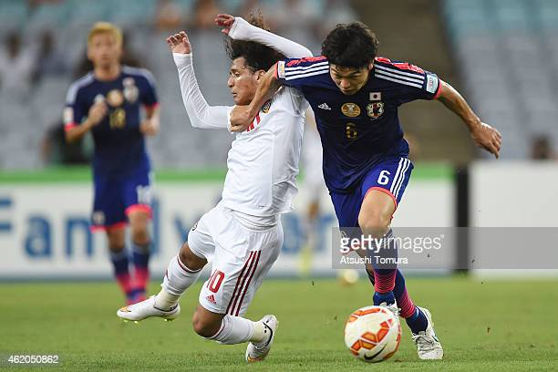 Masato Morishige of Japan controls the ball during the 2015 Asian Cup Quarter Final match between Japan and the United Arab Emirates at ANZ Stadium...