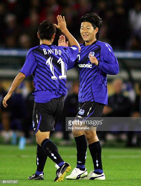 Masato Yamazaki of Gamba Osaka celebrates their first goal with teammate Ryuji Bando during the FIFA Club World Cup Japan 2008 third place match...