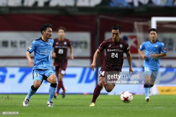 Masatoshi Mihara of Vissel Kobe and Akihiro Ienaga of Kawasaki Frontale compete for the ball during the JLeague J1 match between Vissel Kobe and...