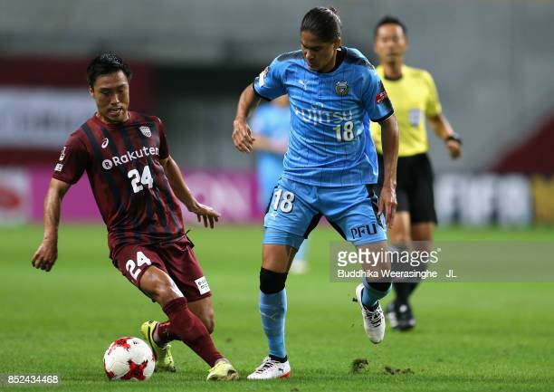 Masatoshi Mihara of Vissel Kobe and Elsinho of Kawasaki Frontale compete for the ball during the JLeague J1 match between Vissel Kobe and Kawasaki...