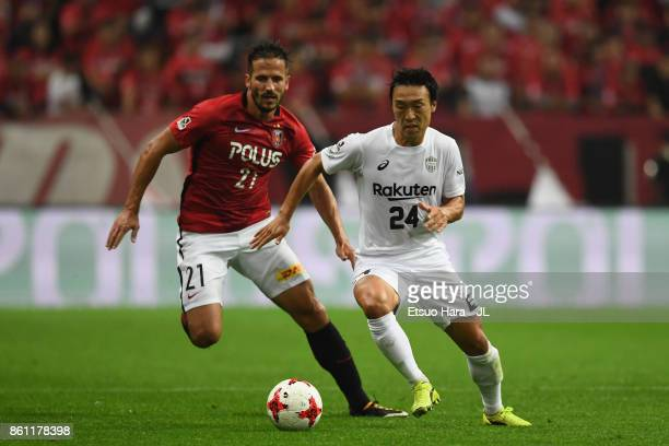 Masatoshi Mihara of Vissel Kobe and Zlatan Ljubijankic of Urawa Red Diamonds compete for the ball during the JLeague J1 match between Urawa Red...