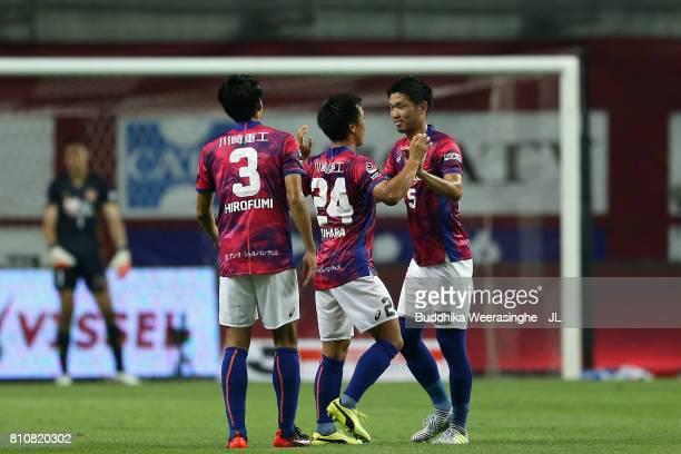 Masatoshi Mihara of Vissel Kobe celebrates scoring his side's first goal with his team mates Hirofumi Watanabe and Takuya Iwanami during the JLeague...