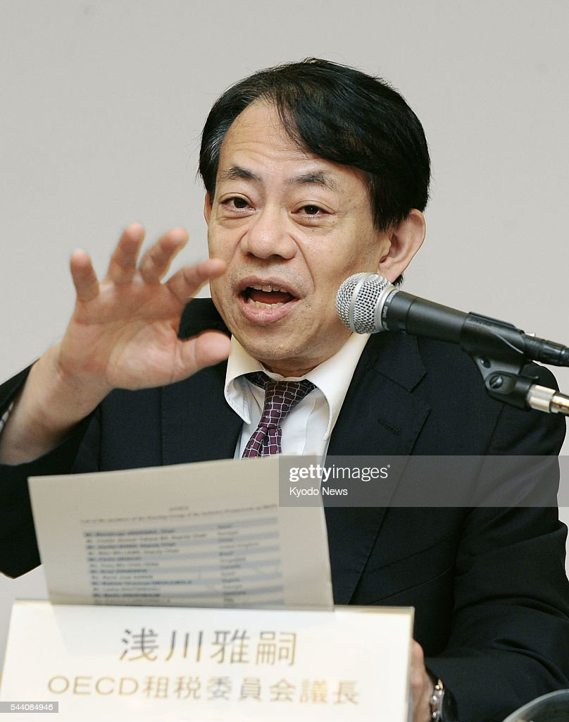 Masatsugu Asakawa, the Japanese Finance Ministry's vice minister for international affairs, attends a press conference in Kyoto on July 1, 2016, after a two-day meeting of the Organization for Economic Cooperation and Development. Asakawa called the meeting 'a major achievement,' enabling the group to 'take the first step' in accelerating global cooperation to tackle tax avoidance.