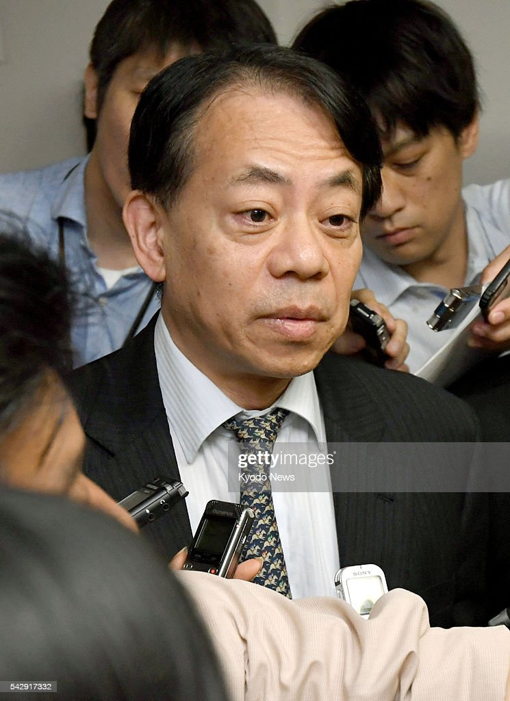Masatsugu Asakawa, vice minister for international affairs at Japan's Finance Ministry, speaks to reporters after a meeting between government and Bank of Japan officials in Tokyo on June 25, 2016. The two sides agreed to work closely to prepare for any further financial market volatility following Britain's decision to leave the European Union.