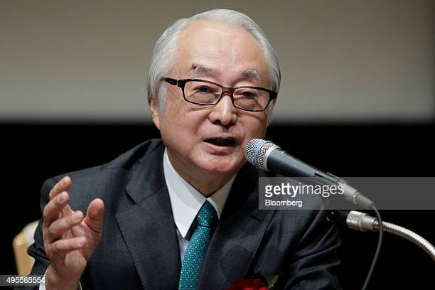 Masatsugu Nagato president of Japan Post Bank Co speaks during a news conference following the company's listing on the Tokyo Stock Exchange in Tokyo...
