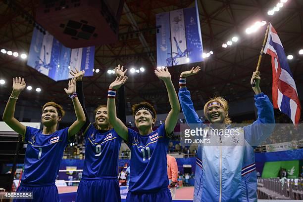 Masaya Duangsri Wanwisa Jankaen Payom Srihongsa and Fueangfa Praphatsarang of Thailand celebrate their win against South Korea following the women's...