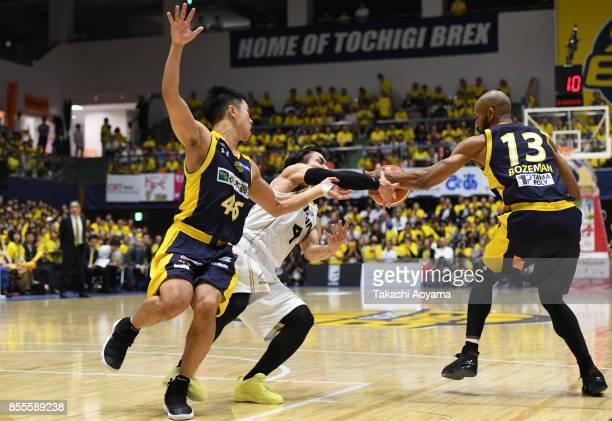 Masaya Karimata of the SeaHorse Mikawa competes for the ball against Cedric Bozeman of the Tochigi Brex during the BLeague game between Tochigi Brex...