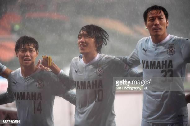 Masaya Matsumoto Shunsuke Nakamura and Yoshiaki Fujita of Jubilo Iwata celebrate their 21 victory in the JLeague J1 match between Jubilo Iwata and...