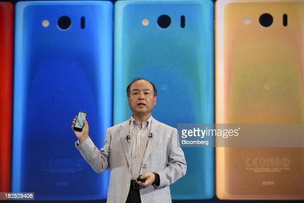 Masayoshi Son chairman and chief executive officer of SoftBank Corp introduces the company's Aquos mini 303SH smartphone during a product launch in...