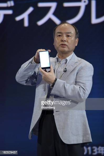 Masayoshi Son chairman and chief executive officer of SoftBank Corp introduces the company's Aquos Xx302SH smartphone during a product launch in...