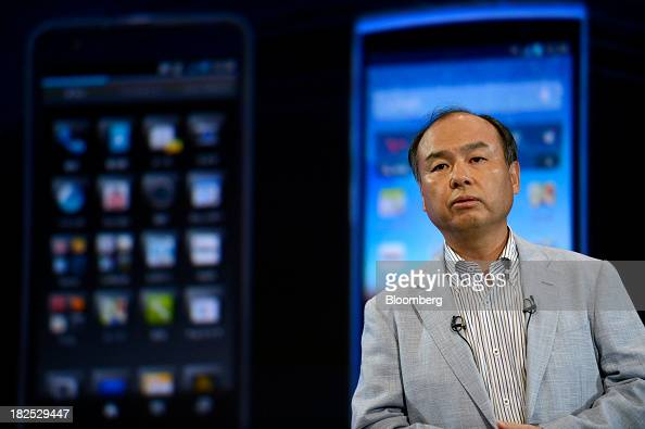 Masayoshi Son chairman and chief executive officer of SoftBank Corp introduces the company's Aquos smartphones during a product launch in Tokyo Japan...