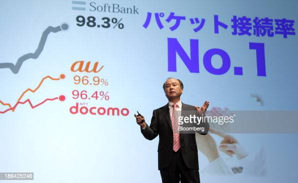 Masayoshi Son chairman and chief executive officer of SoftBank Corp gestures as he speaks during a news conference in Tokyo Japan on Thursday Oct 31...