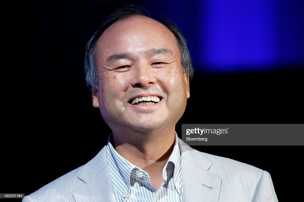 <a gi-track='captionPersonalityLinkClicked' href=/galleries/search?phrase=Masayoshi+Son&family=editorial&specificpeople=632759 ng-click='$event.stopPropagation()'>Masayoshi Son</a>, chairman and chief executive officer of SoftBank Corp., reacts as he speaks at SoftBank World 2014 in Tokyo, Japan, on Tuesday, July 15, 2014. As Son pushes for a takeover of T-Mobile US Inc., the Japanese billionaire is asking banks to commit financing for a longer-than-usual amount of time, underscoring the intense regulatory review he faces. Photographer: Kiyoshi Ota/Bloomberg via Getty Images