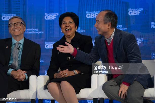 Masayoshi Son chairman and chief executive officer of SoftBank Group Corp from left speaks while Indra Nooyi chief executive officer and chairman of...