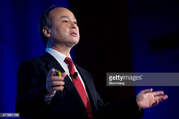 Masayoshi Son chairman president and chief executive officer of SoftBank Corp speaks during a presentation at the Chamber of Commerce in Washington...