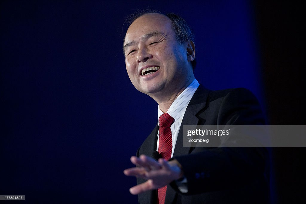 <a gi-track='captionPersonalityLinkClicked' href=/galleries/search?phrase=Masayoshi+Son&family=editorial&specificpeople=632759 ng-click='$event.stopPropagation()'>Masayoshi Son</a>, chairman, president and chief executive officer of SoftBank Corp., smiles during a presentation at the Chamber of Commerce in Washington, D.C., U.S., on Tuesday, March 11, 2014. The billionaire, who bought control of the third-largest wireless carrier last year, said combining with fourth-ranked T-Mobile would give him scale to compete against AT&T Inc. and Verizon Communications Inc. Photographer: Andrew Harrer/Bloomberg via Getty Images