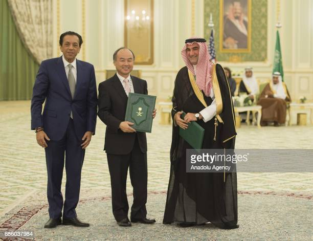 Masayoshi Son Chief Executive Officer of SoftBank and Yasir bin Othman AlRumayyan the Chief Executive Managing Director and SecretaryGeneral of the...