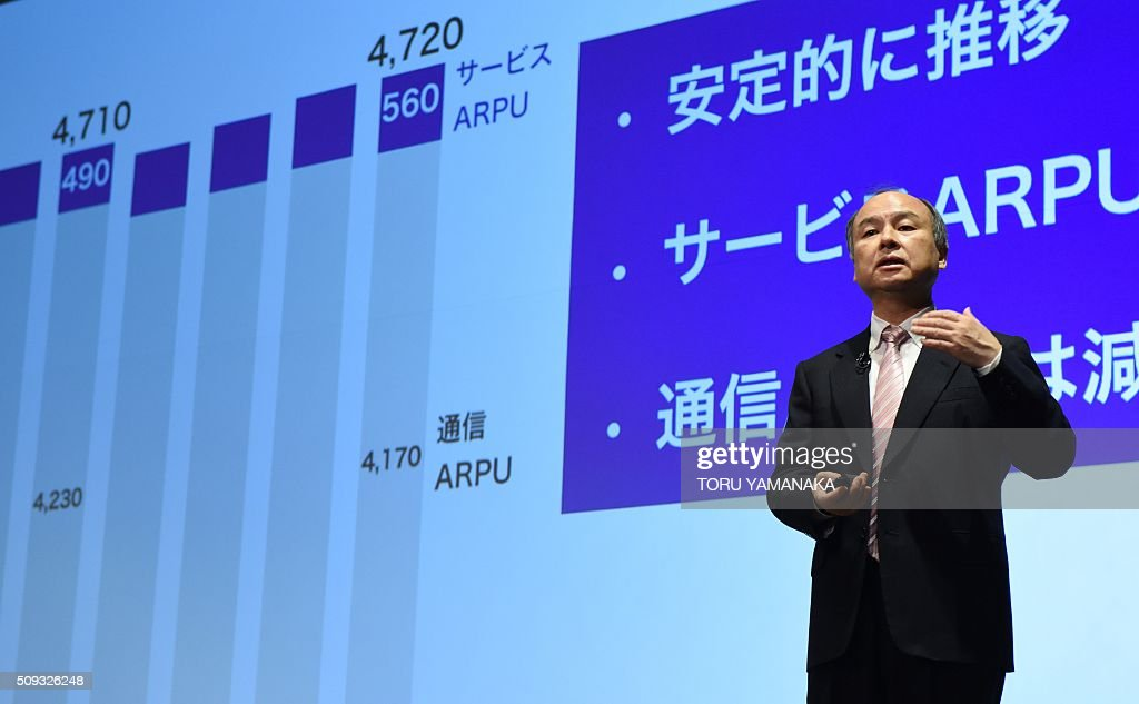Masayoshi Son, president of Japan's telecom and Internet group SoftBank Group, gestures as he speaks to journalists during a press conference in Tokyo on February 10, 2016. SoftBank said its consolidated net profit in the April to December period fell 26 percent from a year earlier, due partly to a huge one-time gain booked in the previous business year linked to its investment in Chinese e-commerce giant Alibaba Group Holdings Ltd. AFP PHOTO / Toru YAMANAKA / AFP / TORU YAMANAKA