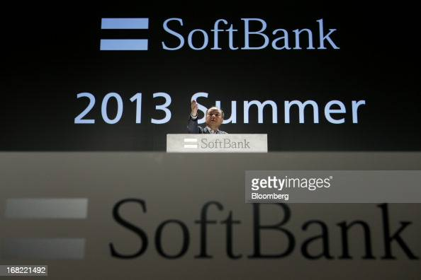 Masayoshi Son president of SoftBank Corp gestures during a QA session at a product launch in Tokyo Japan on Tuesday May 7 2013 Son will visit the US...