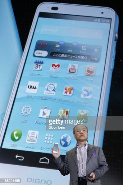 Masayoshi Son president of SoftBank Corp introduces the company's Digno R 202K smartphone manufactured by Kyocera Corp during a product launch in...