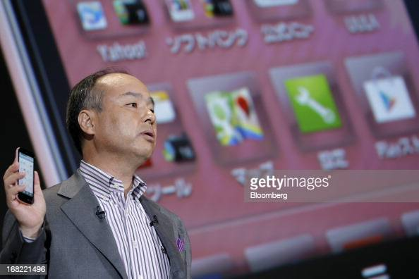 Masayoshi Son president of SoftBank Corp introduces the company's Aquos Phone SS 205SH smartphone manufactured by Sharp Corp during a product launch...