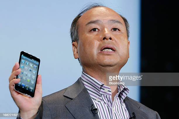 Masayoshi Son president of SoftBank Corp introduces the company's Aquos Phone Xx 206SH smartphone manufactured by Sharp Corp during a product launch...