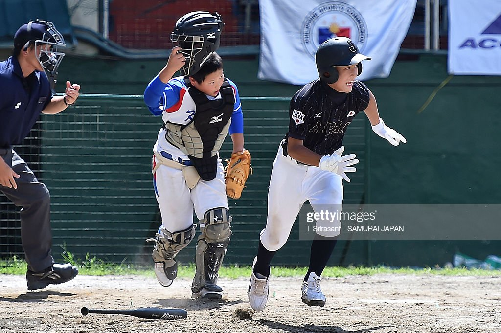 <a gi-track='captionPersonalityLinkClicked' href=/galleries/search?phrase=Masayoshi+Yamada&family=editorial&specificpeople=13526079 ng-click='$event.stopPropagation()'>Masayoshi Yamada</a> #6 of Japan runs during the 8th 12U Asian Baseball Championship game between South Korea and Japan at Rizal Memorial Baseball Stadium on August 30, 2014 in Manila, Philippines.